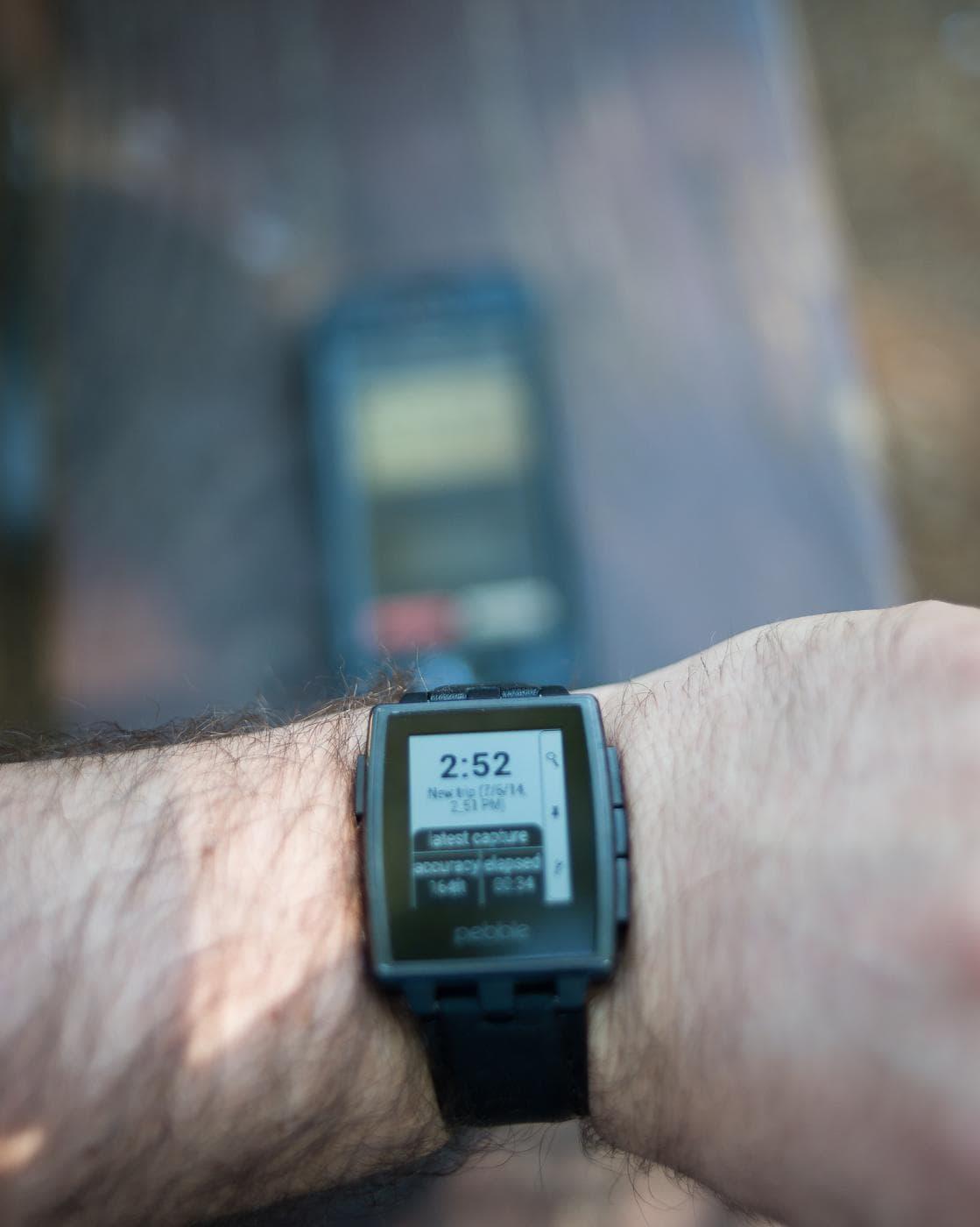 GPS4cam & Pebble Smartwatch Sitting On A Wrist
